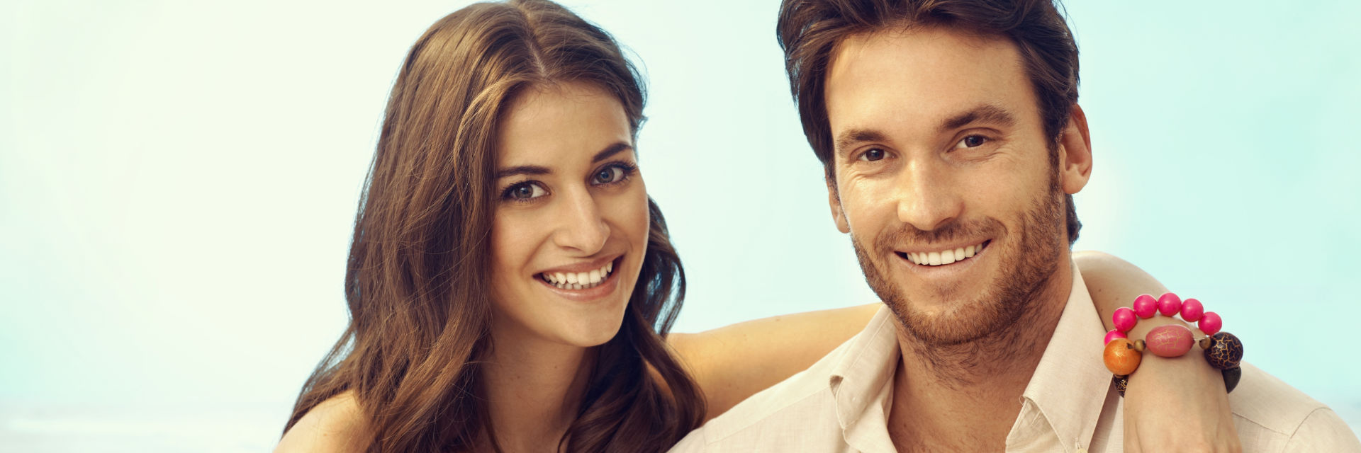 A cheerful young couple with perfect smiles.