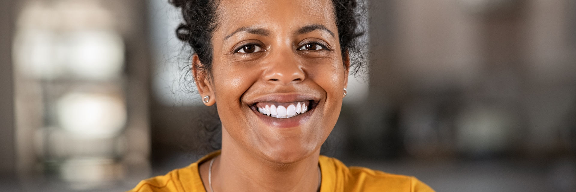 A happy middle-aged woman showing beautiful white teeth in her smile.