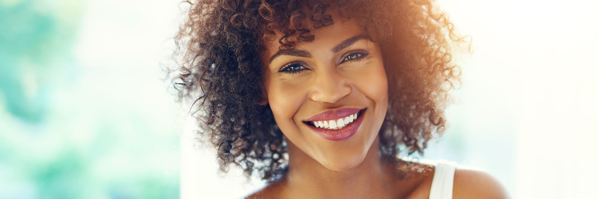 A happy young woman with a perfect smile.