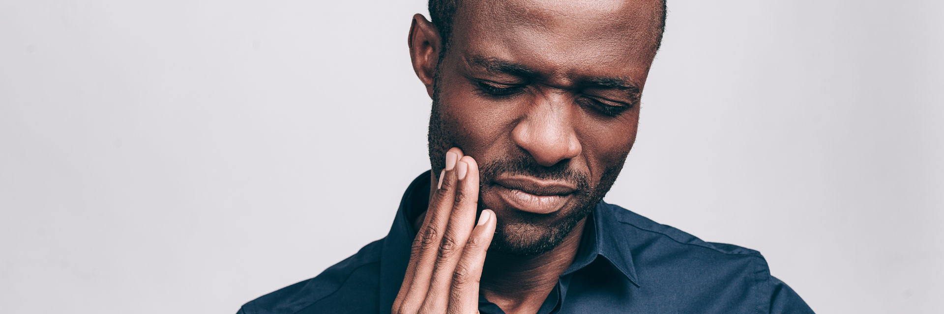 An Afro-American man with dental pain.